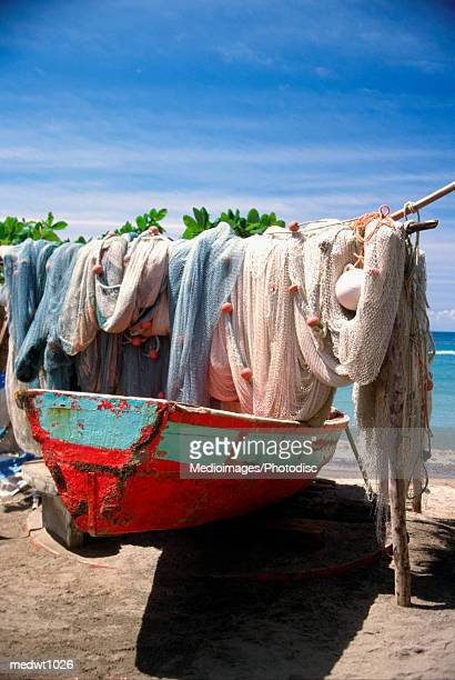 fishing net hanging on boat at anse la raye in st. lucia, caribbean - raye stock pictures, royalty-free photos & images
