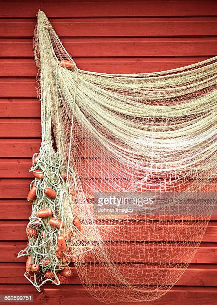 Fishing net hanging on wall