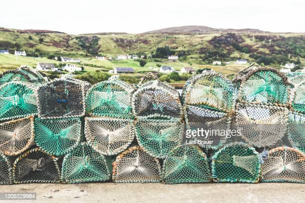 fishing net in the habour of uig in scotland - fishing industry stock pictures, royalty-free photos & images