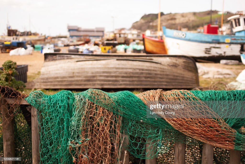Fishing nets and fishing boats on beach : Stock Photo