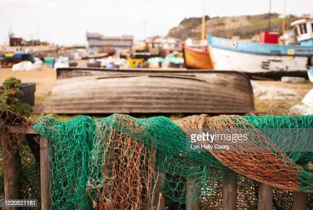fishing nets and fishing boats on beach - lyn holly coorg stock pictures, royalty-free photos & images