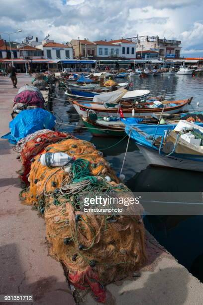 fishing nets on the floor at marina in urla. - emreturanphoto stock pictures, royalty-free photos & images