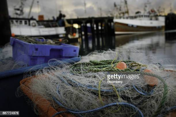 Fishing nets sit in containers on the dockside near fishing vessels at moorings in Newlyn UK on Wednesday Nov 29 2017 Prime Minister Theresa May will...