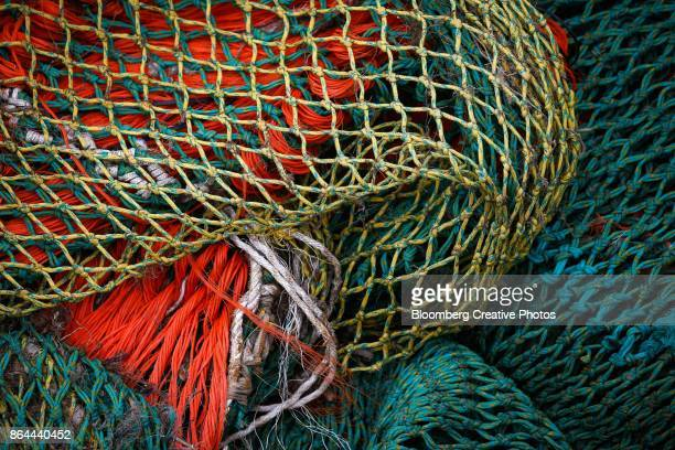 Fishing nets sit on the deck of a trawler vessel in Newlyn harbour