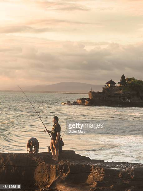 Fishing next to the famous Tanah Lot in Bali Indonesia