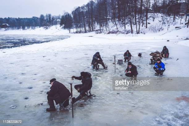 fishing on ice - ice fishing stock pictures, royalty-free photos & images