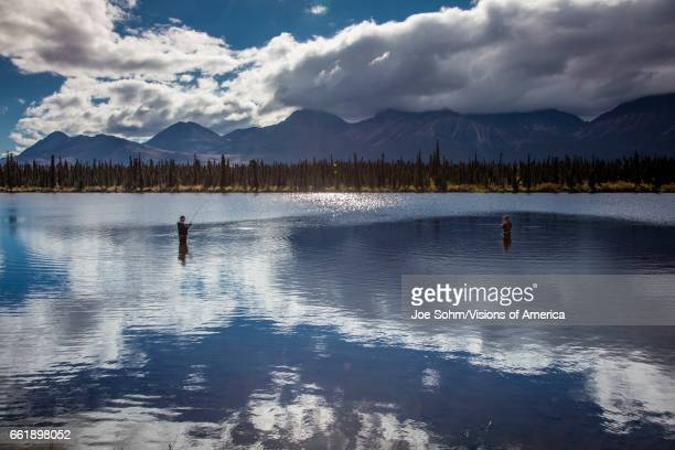 fishing on lakes of Central Alaskan Range Route 8 Denali Highway Alaska a dirt road offers stunning views of Mnt Hess Mountain Mt Hayes and Mnt...