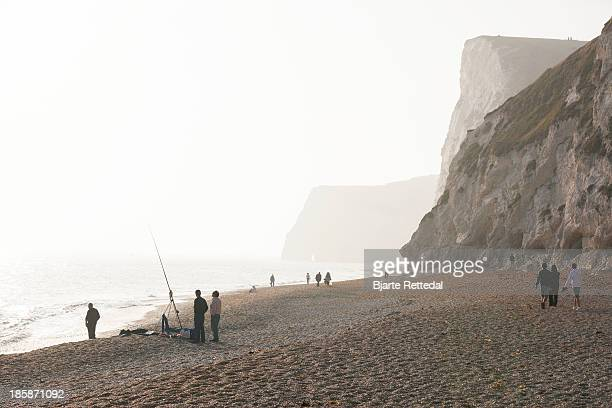 fishing on the beach - bjarte rettedal stock pictures, royalty-free photos & images
