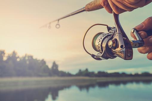 Fishing on the lake at sunset. Fishing background. 942157916