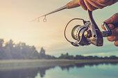 Fishing on the lake at sunset. Fishing background.