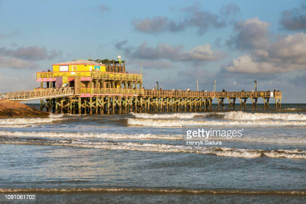 fishing pier in galveston - galveston stock pictures, royalty-free photos & images