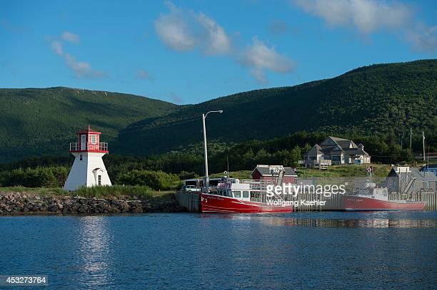 Fishing port of Pleasant Bay with lighthouse along the west coast of Cape Breton Island Nova Scotia Canada