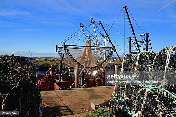 fishing pots and nets in the harbour. - crab pot stock photos and pictures