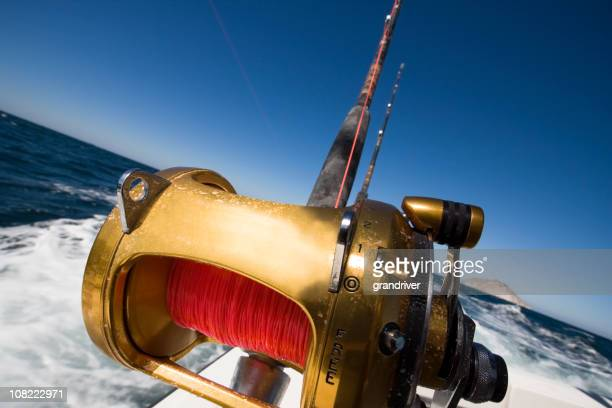 fishing reel on an ocean boat - big game fishing stock photos and pictures