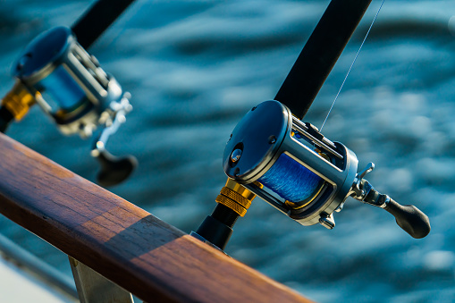 Fishing rod and reel on boat 874138962