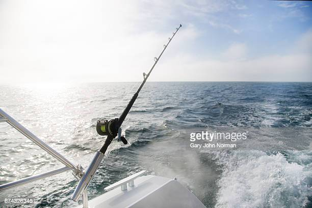 Fishing rod on back of yacht, early morning