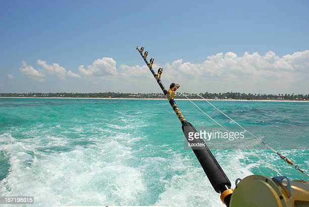fishing rod on the rear of a boat - big game fishing stock photos and pictures
