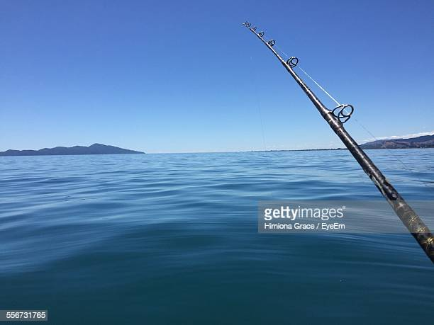Fishing Rod Over Sea Against Clear Sky