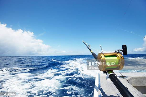 fishing rods on fishing boat. - shizuoka stock photos and pictures