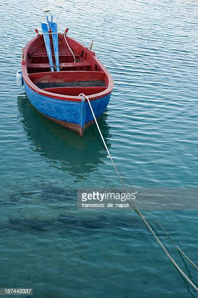 fishing rowboat in little port of giovinazzo, apulia (southern italy) - goiter stock pictures, royalty-free photos & images