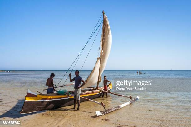 fishing scene in madagascar - dugout canoe stock photos and pictures
