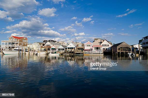 fishing shacks and cottages on cape may harbor - cape may stock pictures, royalty-free photos & images