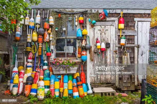 fishing shed decorated with lobster buoys - lobster fishing stock photos and pictures