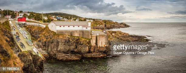 Fishing sheds and cliffs with stratum along the Atlantic coastline
