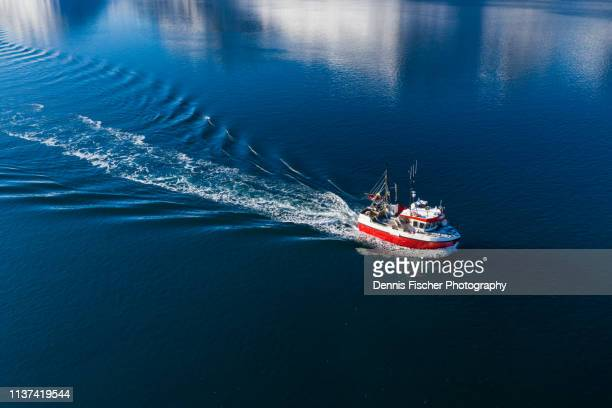 a fishing ship on a cruise in norway - fishing boat stock pictures, royalty-free photos & images