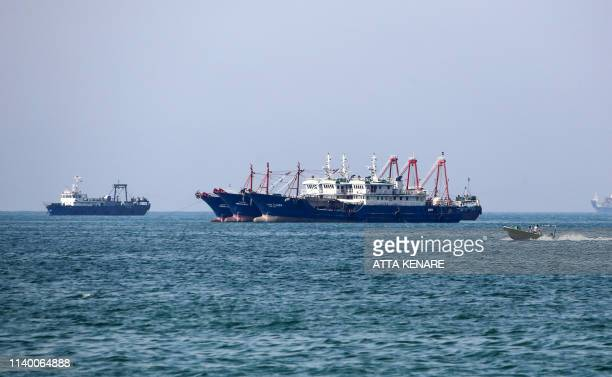Cargo ships sail in the Gulf off the Iranian port city of Bandar Abbas, which is the main base of the Islamic republic's navy and has a strategic...