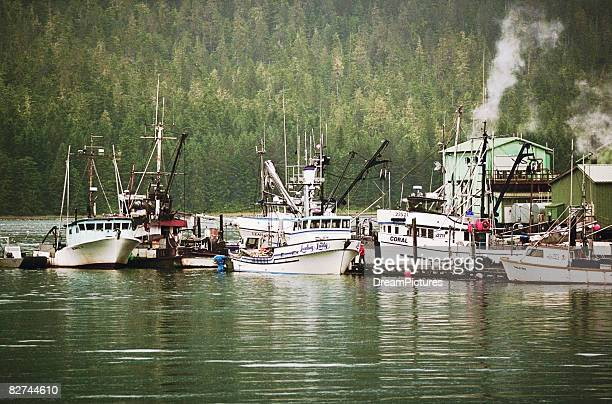 fishing ships at dock - anchorage alaska stock photos and pictures