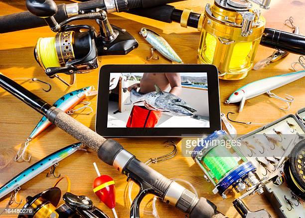 Fishing still life with snapshot on a digital tablet