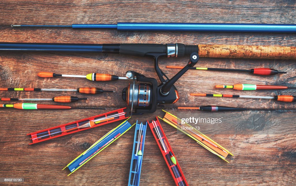 Fishing Tackle On A Old Wooden Table Sport And Recreation Concept