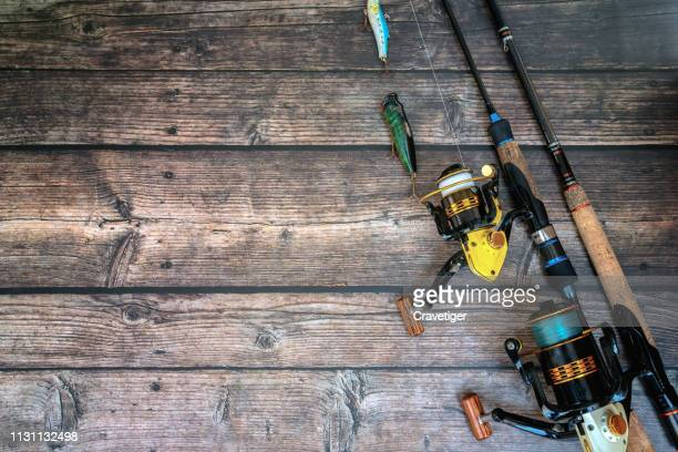 fishing tackle on the wood background. - fishing tackle stock pictures, royalty-free photos & images