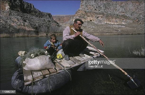 Fishing techniques used on the Euphrates river The currents of the river are used to propell these rafts The shovels used as oars are also used to...