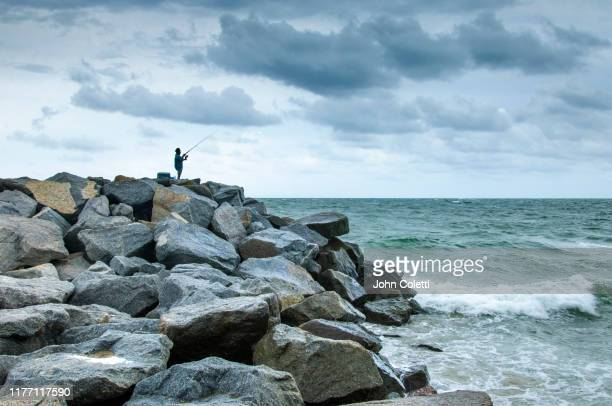fishing, the fort lauderdale beach jetties, fort lauderdale, florida - atlantic ocean stock pictures, royalty-free photos & images