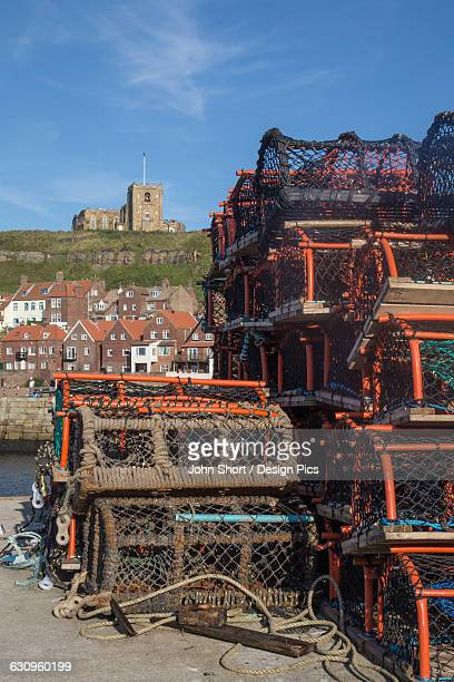 fishing traps on the shore in the harbour - whitby north yorkshire england stock pictures, royalty-free photos & images