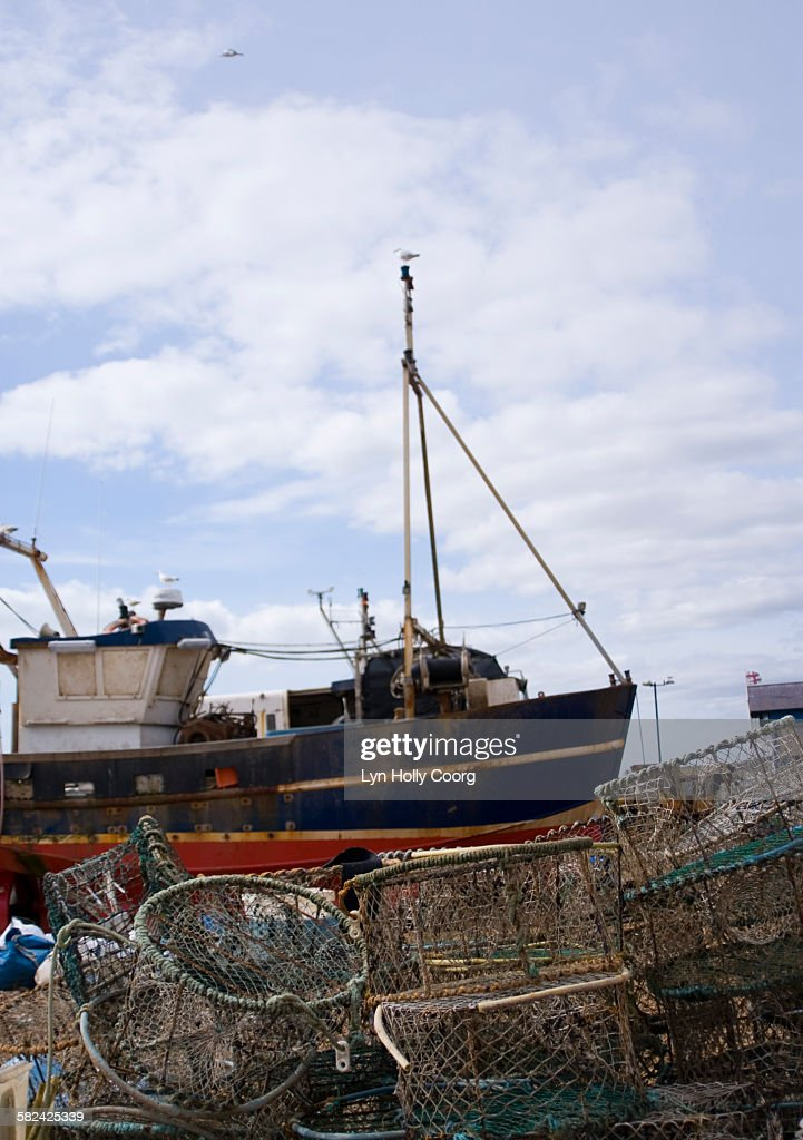 Fishing trawler and lobster pots : Stock Photo