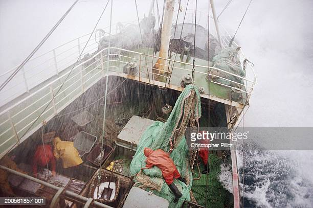 Fishing trawler at sea during storm