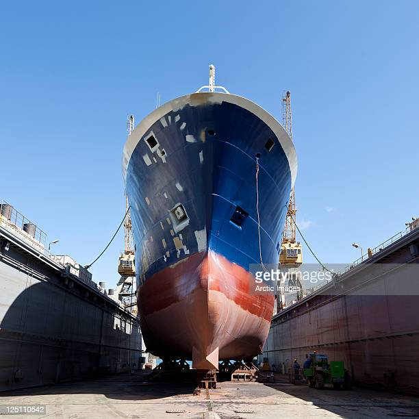 fishing trawler being serviced in shipyard - shipyard stock pictures, royalty-free photos & images