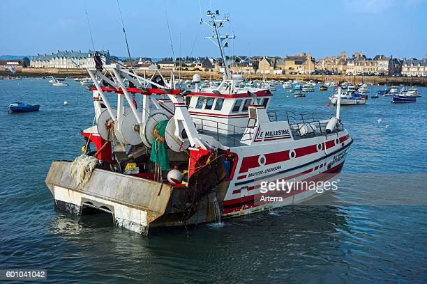 Fishing trawler / dragger entering the Barfleur harbour Lower Normandy France