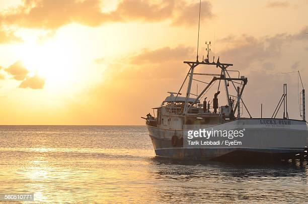 Fishing Trawler In Sea During Sunset