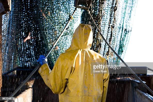 fishing trawler - gabardina ropa impermeable fotografías e imágenes de stock