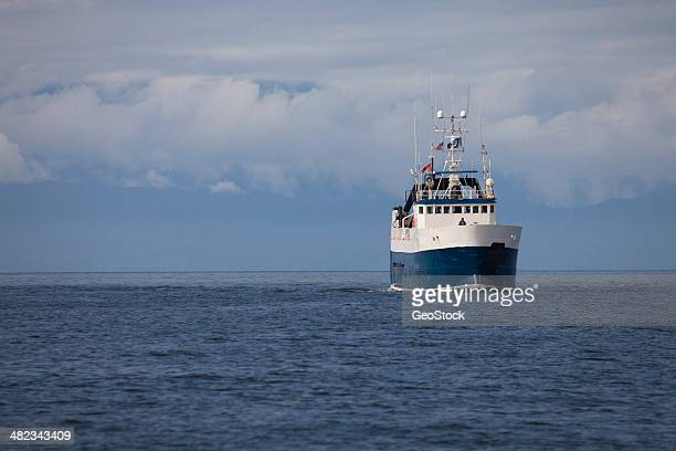 fishing trawler returning to port - pacific ocean stock pictures, royalty-free photos & images