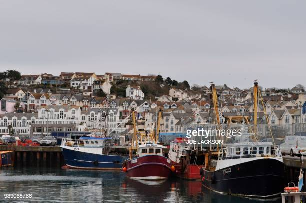 Fishing trawlers are seen in the harbour in the fishing town of Brixham on the south coast of England on March 26 2018 On the dockside in Brixham a...