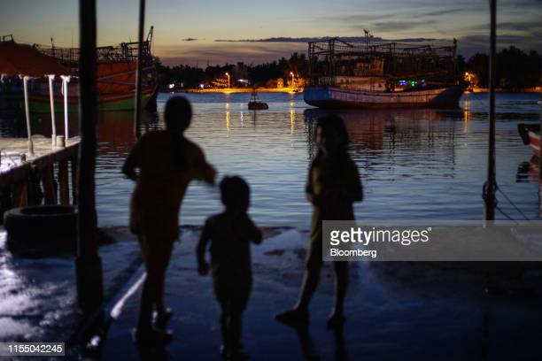 Fishing trawlers sit anchored at dusk in Tan Quang harbor in Quang Nam province Vietnam on Wednesday June 26 2019 Fishermen are on the front lines of...