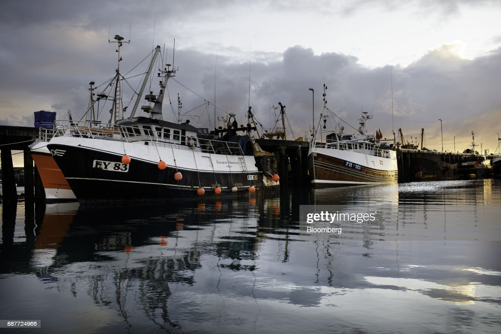 Fishing trawlers sit at their moorings on the dockside in Newlyn harbor in Newlyn, U.K., on Wednesday, Nov. 29, 2017. Prime Minister Theresa May will pull Britain out of the 1964 London convention that allows European fishing vessels to access waters as close as six to twelve nautical miles from the U.K. coastline. Photographer: Annie Sakkab/Bloomberg via Getty Images