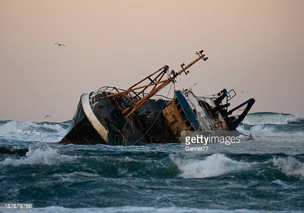 Fishing vessel boat aground on sea