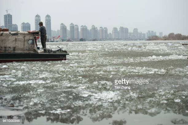 Melting Ice floes float on the Songhuajiang River on April 2 2018 in Harbin ChinaThe Ice floes arriving on the river has attracted many residents and...