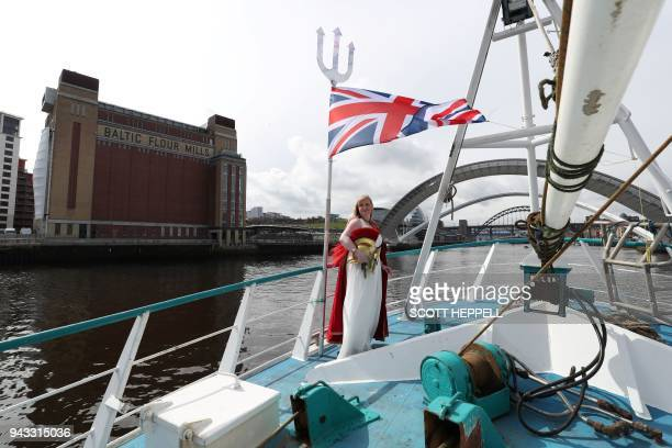 A fishing vessels approaches the Millennium Bridge in Newcastle northeast England on April 8 during a protest against the Brexit transition deal that...